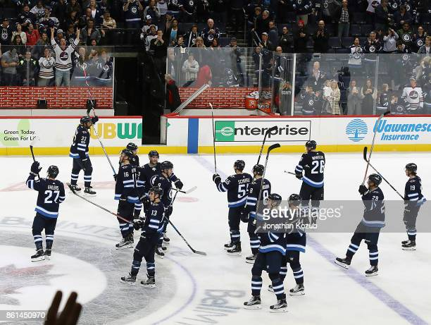 Winnipeg Jets players salute the fans following a 21 victory over the Carolina Hurricanes at the Bell MTS Place on October 14 2017 in Winnipeg...