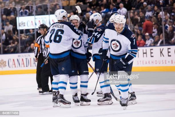 Winnipeg Jets Right Wing Blake Wheeler Left Wing Nikolaj Ehlers Defenceman Joshua Morrissey and Defenceman Ben Chiarot celebrate after a goal during...