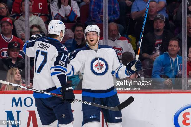 Winnipeg Jets right wing Joel Armia celebrates with teammate Winnipeg Jets center Adam Lowry during the second period of the NHL regular season game...