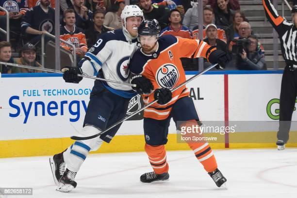 Winnipeg Jets Right Wing Patrik Laine and Edmonton Oilers Defenceman Adam Larsson battle during the Edmonton Oilers game versus the Winnipeg Jets at...