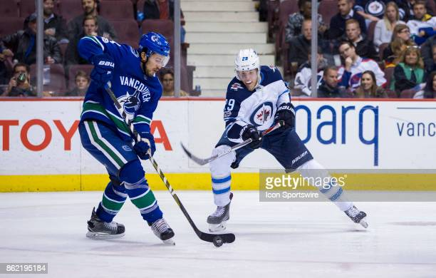 Winnipeg Jets Right Wing Patrik Laine battles with Vancouver Canucks Defenceman Michael Del Zotto in a NHL hockey game on October 12 at Rogers Arena...