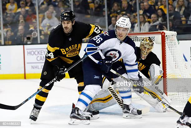 Winnipeg Jets winger Marko Dano tries to set up in front of Boston Bruins goalie Tuukka Rask but Boston Bruins right defenseman Adam McQuaid is there...