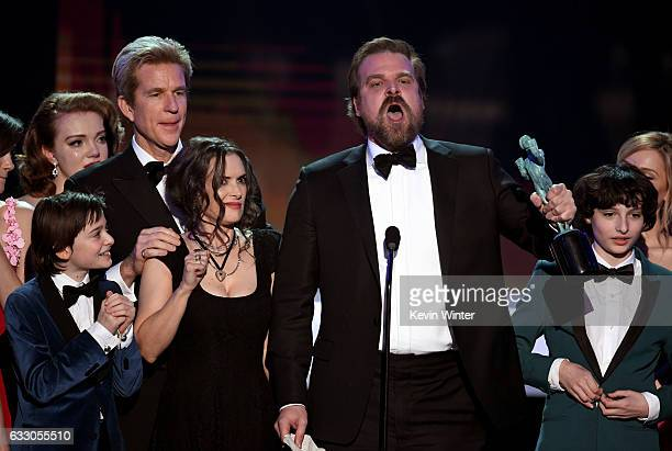 Winona Ryder and David Harbour of 'Stranger Things' accept the Outstanding Performance by an Ensemble in a Drama Series onstage during The 23rd...