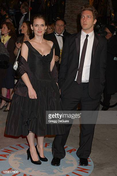 Winona Ryder and Henry Alex Rubin during 2006 Vanity Fair Oscar Party Hosted by Graydon Carter Arrivals at Morton's in West Hollywood California...