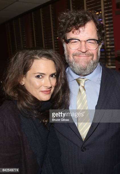 Winona Ryder and Kenneth Lonergan pose at a celebration for 'Manchester By The Sea' Director/Screenwriter/Playwright Kenneth Lonergan's caricature...