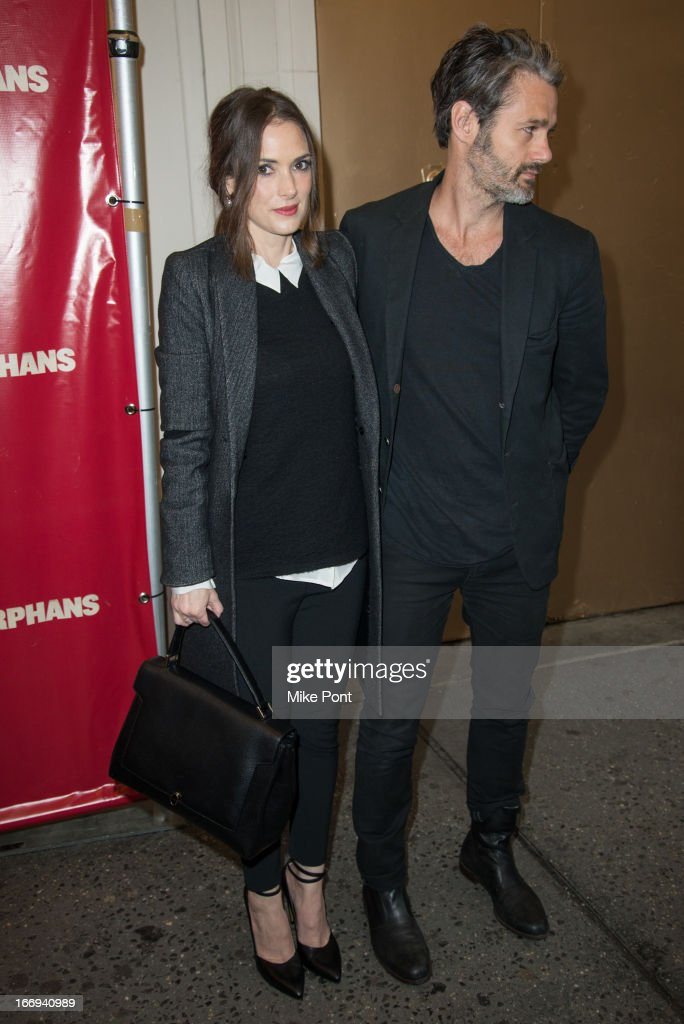 <a gi-track='captionPersonalityLinkClicked' href=/galleries/search?phrase=Winona+Ryder&family=editorial&specificpeople=203145 ng-click='$event.stopPropagation()'>Winona Ryder</a> and Scott Mackinlay Hahn attend the 'Orphans' Broadway opening night at the Gerald Schoenfeld Theatre on April 18, 2013 in New York City.