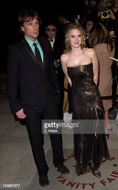 Winona Ryder date during 2001 Vanity Fair Oscar Party Arrivals at Morton's Restaurant in Beverly Hills California United States