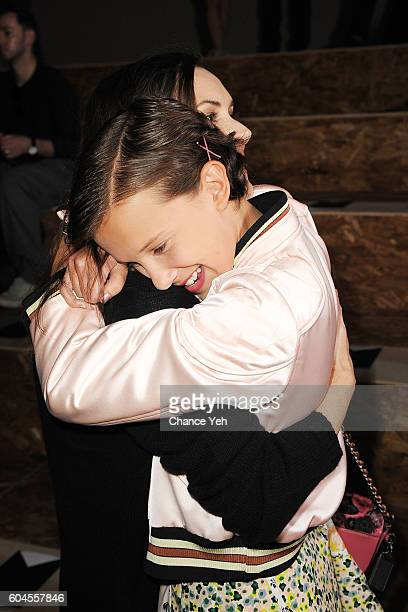 Winona Ryder hugs Millie Bobby Brown at the Coach 1941 Women's Spring 2017 Show at Pier 76 on September 13 2016 in New York City