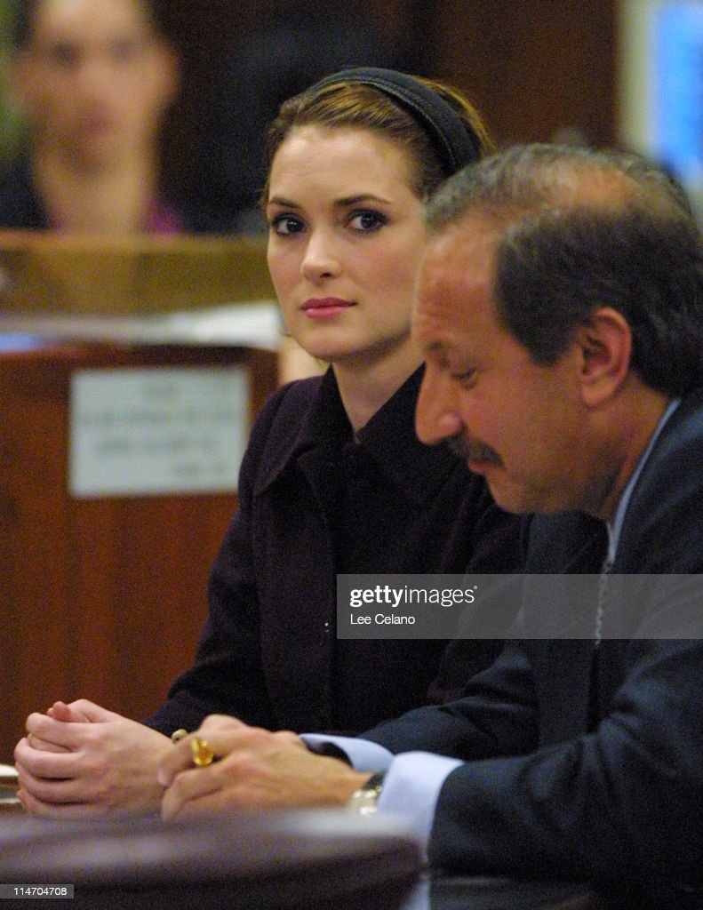 Winona Ryder with her defense attorney Mark Geragos as they listen to verdicts returned in her shoplifting trial November 6 2002 in Los Angeles...