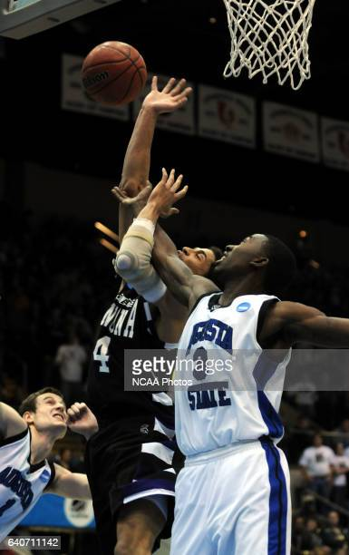 Winona State's Quincy Henderson gets tangled up with Augusta State's Demetetrius Howard as they battle for a rebound during the Division II Men's...
