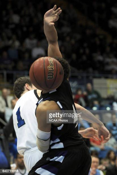 Winona State's Quincy Henderson has his face blocked by the ball as he and Augusta State's Ben Madgen scrap for a rebound during the Division II...