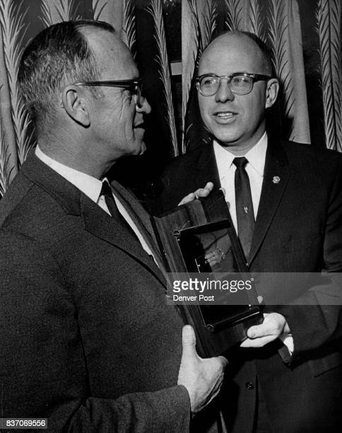 Wins National Honor Harry W Vogler president of Central Auto Electric Co 1171 Lincoln St is shown receiving a plaque from FN McNulty Pomona Calif...