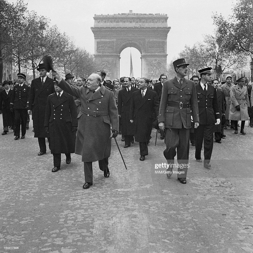 Winston Churchill and General Charles de Gaulle at the French armistice day parade in Paris, 11 November 1944.