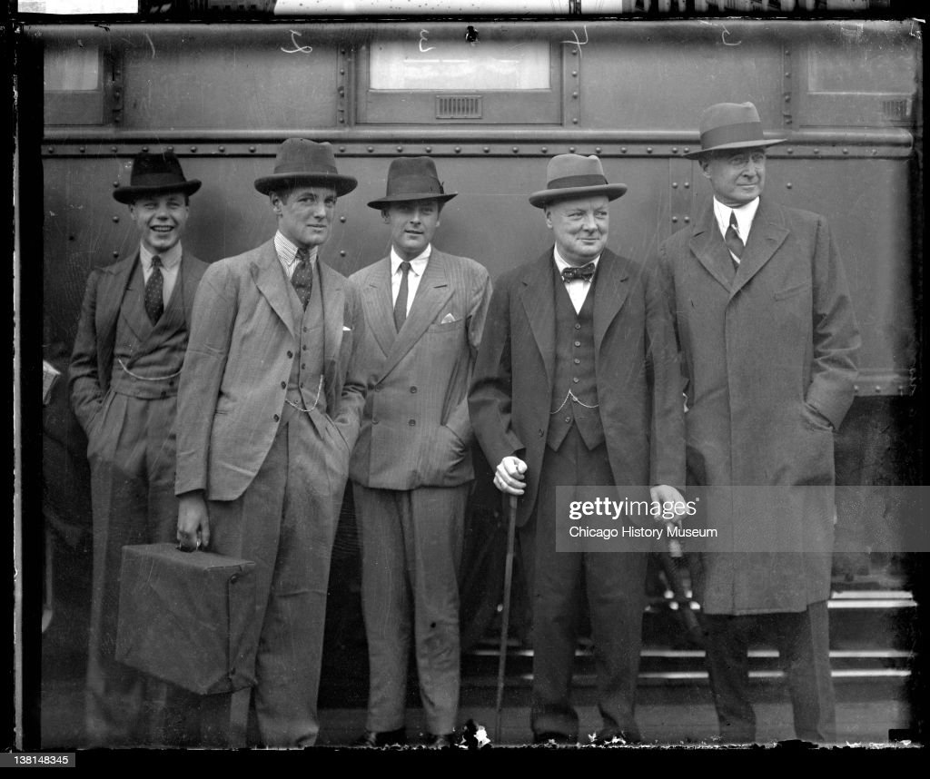 <a gi-track='captionPersonalityLinkClicked' href=/galleries/search?phrase=Winston+Churchill+-+Prime+Minister&family=editorial&specificpeople=92991 ng-click='$event.stopPropagation()'>Winston Churchill</a>, <a gi-track='captionPersonalityLinkClicked' href=/galleries/search?phrase=Bernard+Baruch&family=editorial&specificpeople=215235 ng-click='$event.stopPropagation()'>Bernard Baruch</a> and two other men standing in front of a train car in a railroad station, Chicago, Illinois, 1929. From the Chicago Daily News collection.