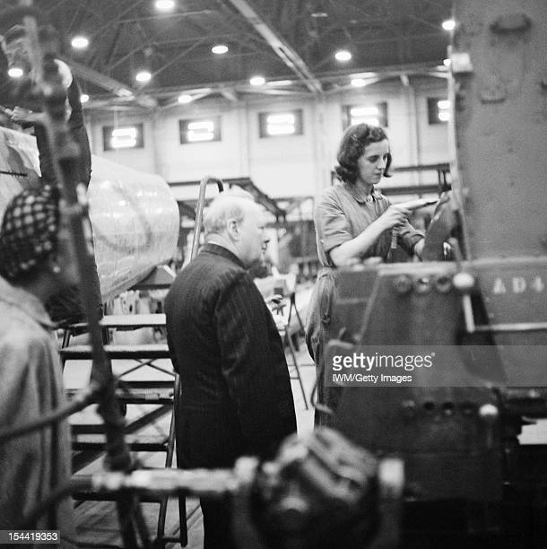 Winston Churchill During The Second World War In The United Kingdom The Prime Minister Winston Churchill observes a female riveter working on a...