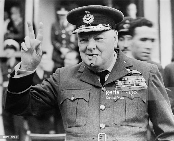 Winston Churchill gives his famous vsign as he opens the new headquarters of 615 Squadron of the RAAF at Croydon 1948