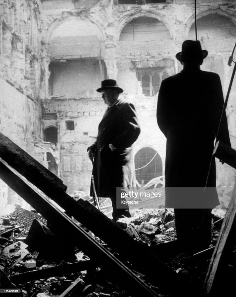 Winston Churchill, the prime minister and Irish journalist and Conservative politician Brendan Bracken (1901 - 1958) survey bomb damage to the Houses of Parliament, London.