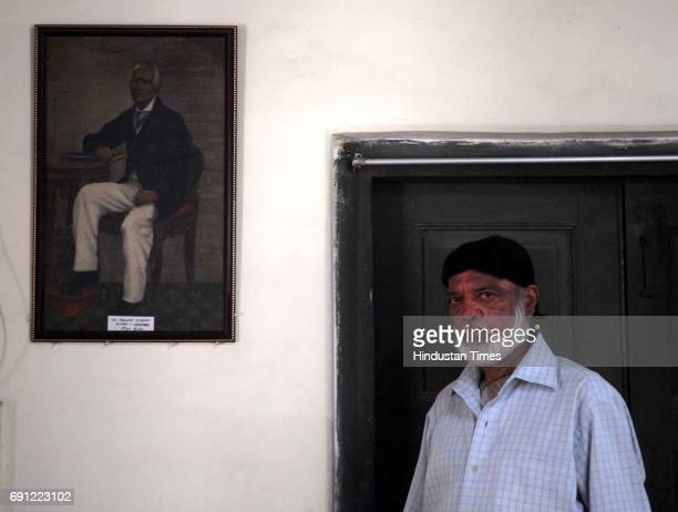 Winston D'Abreo with his great grandfather's painted portrait at his home in Prabhadevi