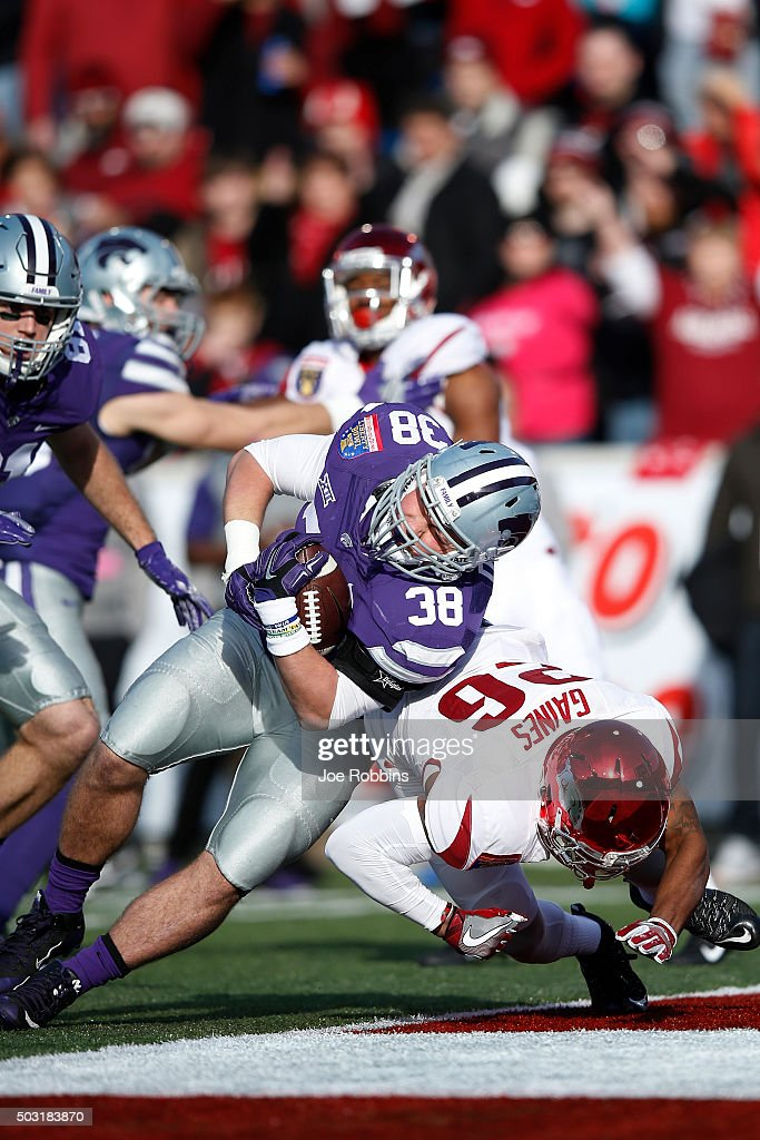 Winston Dimel of the Kansas State Wildcats pushes into the end zone for a 10yard touchdown against Rohan Gaines of the Arkansas Razorbacks in the...