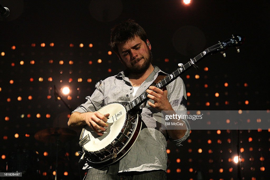 <a gi-track='captionPersonalityLinkClicked' href=/galleries/search?phrase=Winston+Marshall&family=editorial&specificpeople=3124664 ng-click='$event.stopPropagation()'>Winston Marshall</a> of Mumford And Sons performs at the Susquehanna Bank Center February 16, 2013 in Camden, New Jersey.