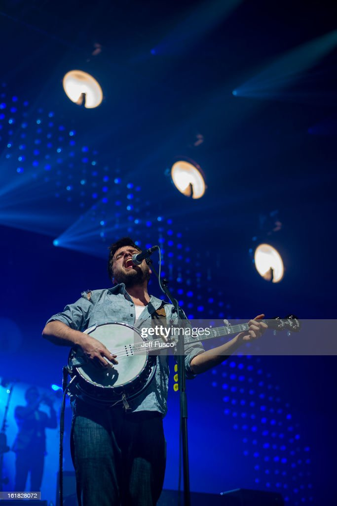 <a gi-track='captionPersonalityLinkClicked' href=/galleries/search?phrase=Winston+Marshall&family=editorial&specificpeople=3124664 ng-click='$event.stopPropagation()'>Winston Marshall</a> of Mumford and Sons performs at the Susquehanna Bank Center on February 16, 2013 in Camden, New Jersey.