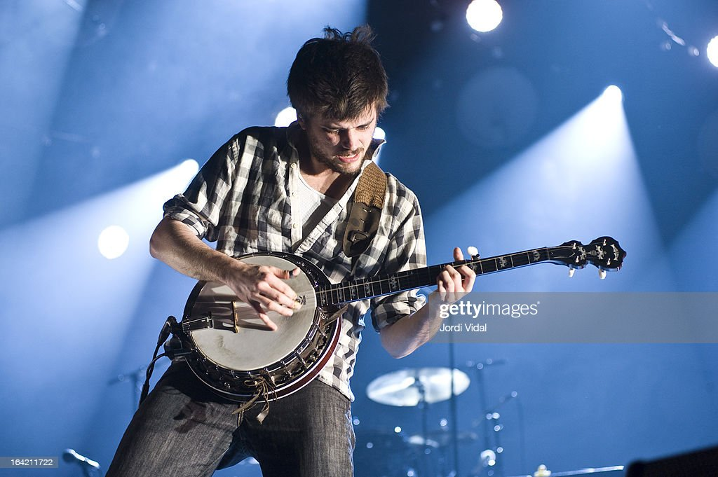 <a gi-track='captionPersonalityLinkClicked' href=/galleries/search?phrase=Winston+Marshall&family=editorial&specificpeople=3124664 ng-click='$event.stopPropagation()'>Winston Marshall</a> of Mumford and Sons performs on stage in concert at Razzmatazz on March 20, 2013 in Barcelona, Spain.