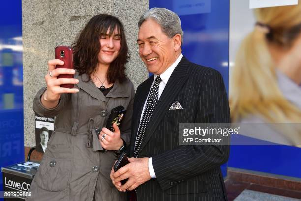 Winston Peters leader of the New Zealand First party poses for a selfie with a supporter outside Bowen House in Wellington on October 19 2017 New...