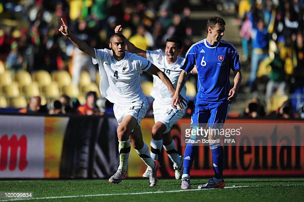 Winston Reid of New Zealand celebrates with team mate Rory Fallon after scoring his team's first goal while Zdenko Strba of Slovakia looks dejected...