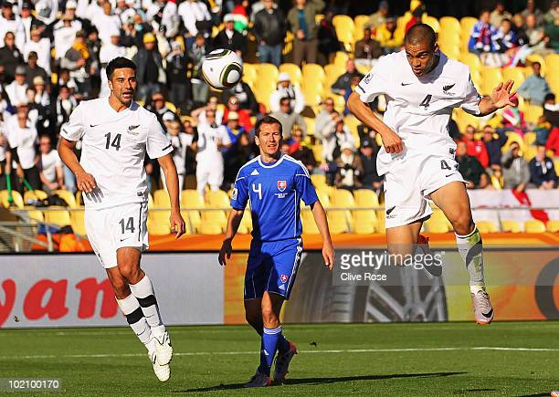 Winston Reid of New Zealand scores the first goal for his team during the 2010 FIFA World Cup South Africa Group F match between New Zealand and...