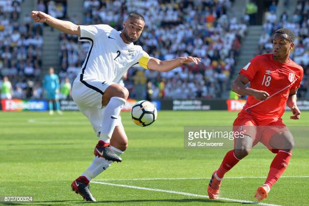 Winston Reid of the All Whites controls the ball from Andre Carrillo of Peru during the 2018 FIFA World Cup Qualifier match between the New Zealand...