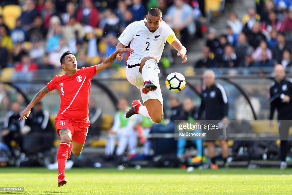 Winston Reid of the All Whites controls the ball from Christian Cueva of Peru during the 2018 FIFA World Cup Qualifier match between the New Zealand All Whites and Peru at Westpac Stadium on November 11, 2017 in Wellington, New Zealand.