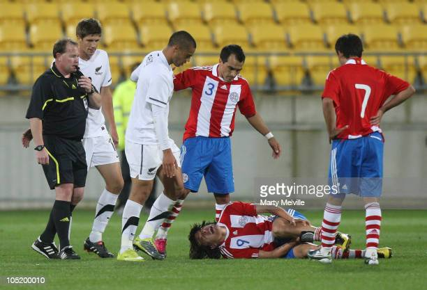 Winston Reid of the All Whites looks down at Federico Santander of Paraguay after being red carded during the International Friendly match between...