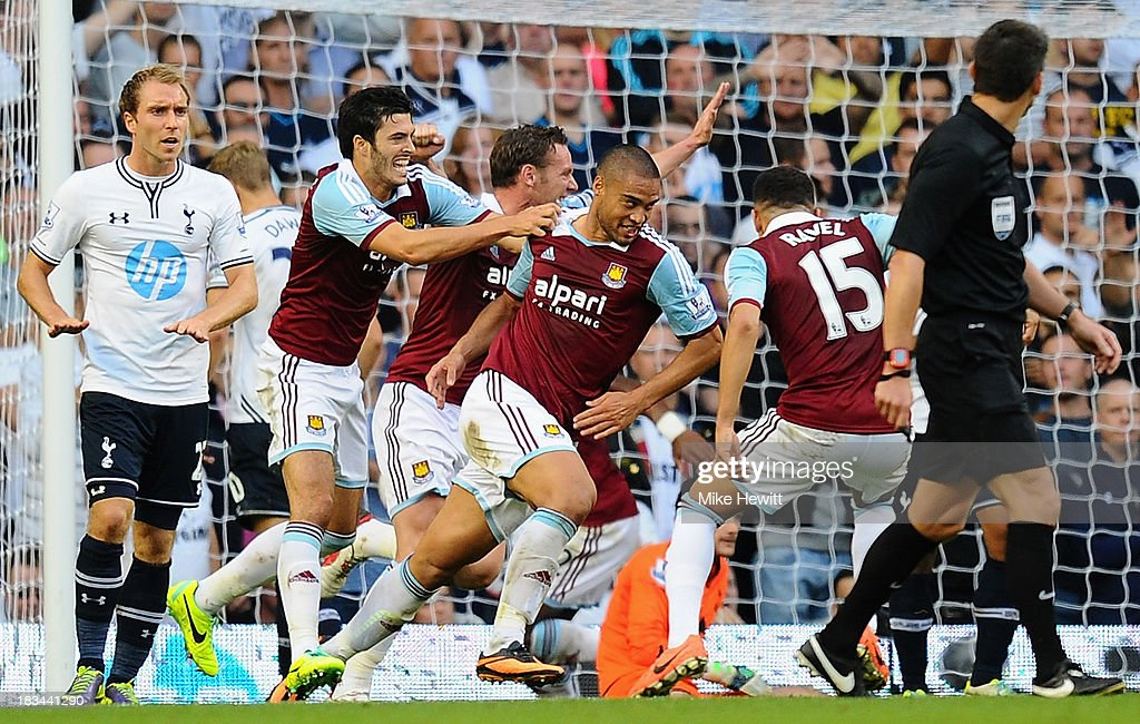 <a gi-track='captionPersonalityLinkClicked' href=/galleries/search?phrase=Winston+Reid&family=editorial&specificpeople=5491819 ng-click='$event.stopPropagation()'>Winston Reid</a> of West Ham (3R) celebrates scoring his side's first goal during the Barclays Premier League match between Tottenham Hotspur and West Ham United at White Hart Lane on October 6, 2013 in London, England.