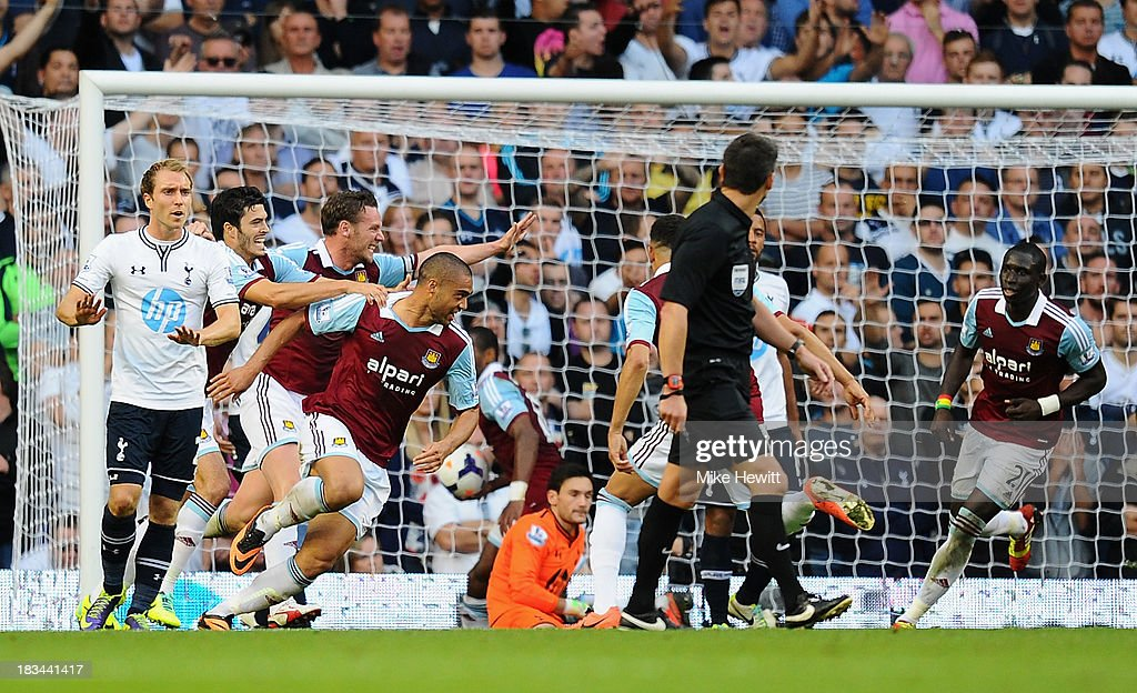 <a gi-track='captionPersonalityLinkClicked' href=/galleries/search?phrase=Winston+Reid&family=editorial&specificpeople=5491819 ng-click='$event.stopPropagation()'>Winston Reid</a> of West Ham (4L) celebrates scoring his side's first goal during the Barclays Premier League match between Tottenham Hotspur and West Ham United at White Hart Lane on October 6, 2013 in London, England.