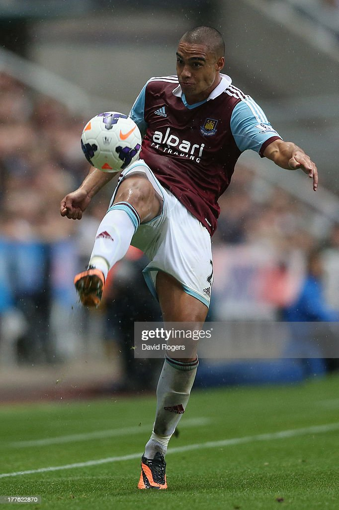 Winston Reid of West Ham clears the ball during the Barclays Premier League match between Newcastle United and West Ham United at St James' Park on August 24, 2013 in Newcastle upon Tyne, England.