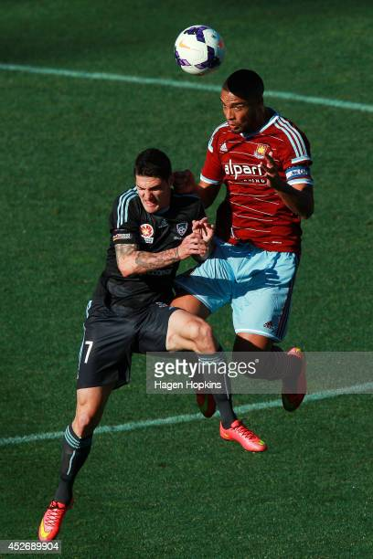 Winston Reid of West Ham United and Corey Gameiro of Sydney FC compete for a header during the Football United New Zealand Tour 2014 match between...