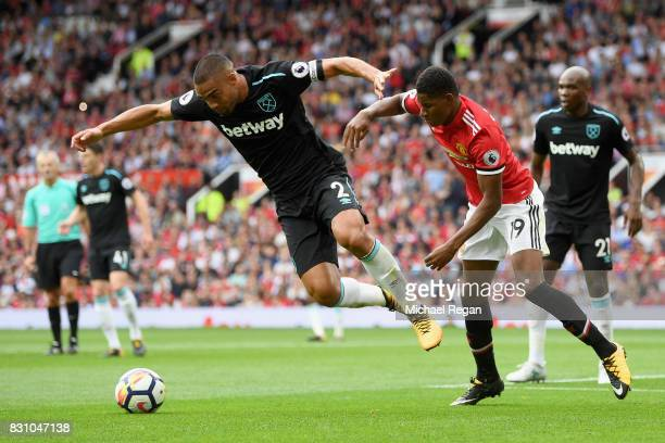 Winston Reid of West Ham United and Marcus Rashford of Manchester United battle for possession during the Premier League match between Manchester...