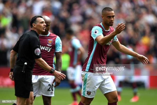 Winston Reid of West Ham United and Neil Swarbrick argue during the Premier League match between West Ham United and Liverpool at London Stadium on...