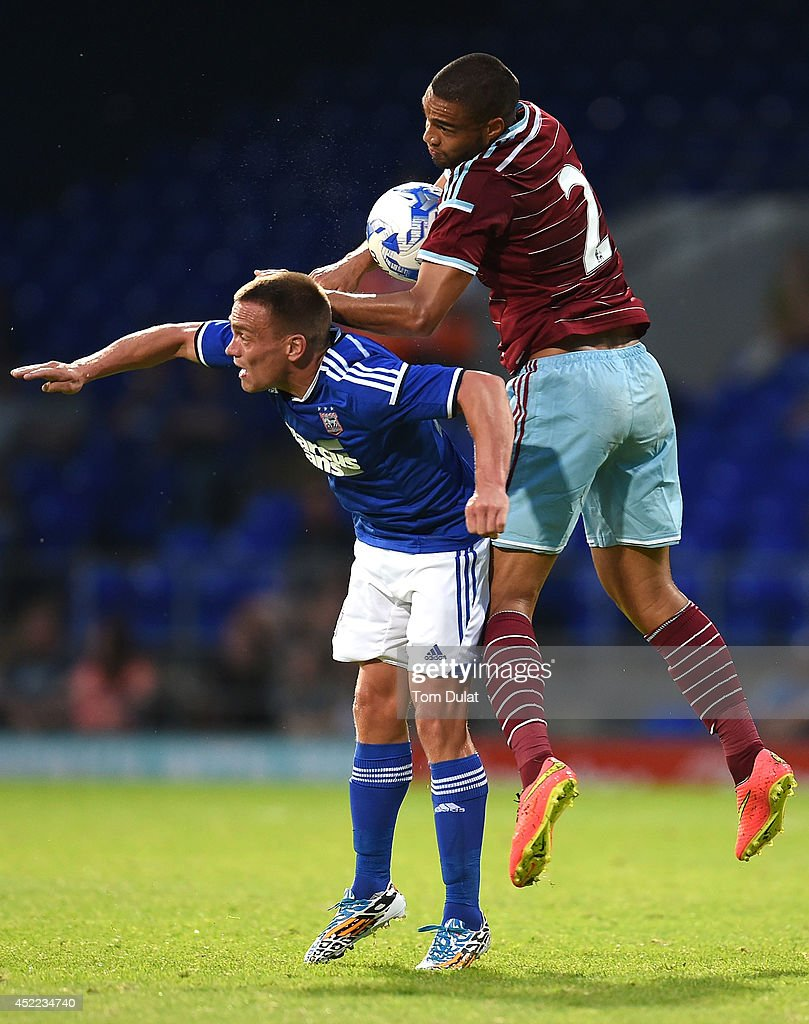 Winston Reid of West Ham United and Paul Taylor of Ipswich Town in action during the pre-season friendly match between Ipswich Town and West Ham United at Portman Road on July 16, 2014 in Ipswich, England.