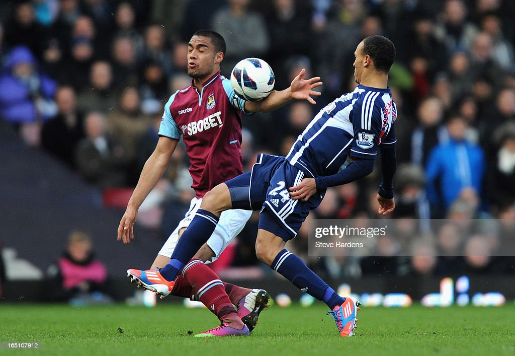 Winston Reid of West Ham United and Peter Odemwingie of West Bromwich Albion tussle for the ball during the Barclays Premier League match between West Ham United and West Bromwich Albion at the Boleyn Ground on March 30, 2013 in London, England.