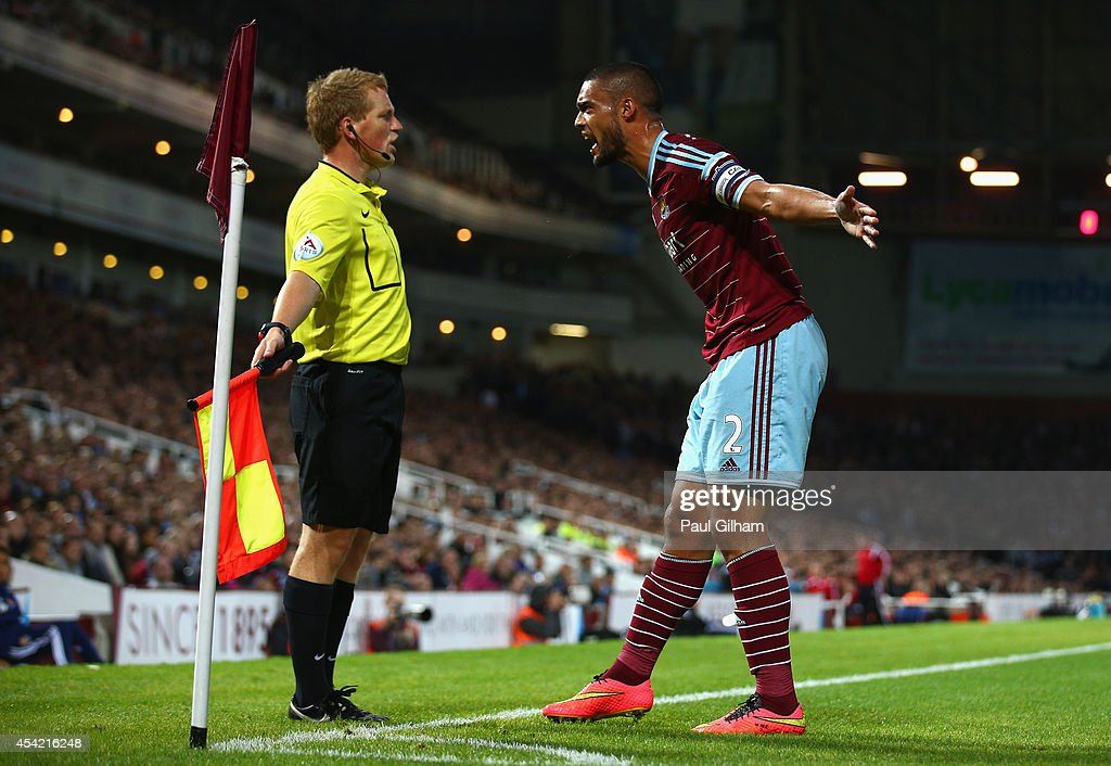 Winston Reid of West Ham United argues with the Assistant Referee during the Capital One Cup between West Ham United and Sheffield United at the Boleyn Ground on August 26, 2014 in London, England.