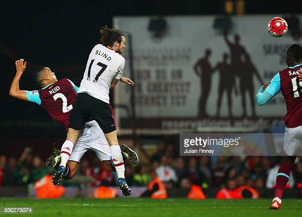 Winston Reid of West Ham United beats Daley Blind of Manchester United to score their third goal during the Barclays Premier League match between...