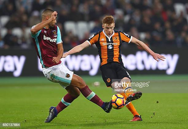 Winston Reid of West Ham United blocks a shot from Sam Clucas of Hull City during the Premier League match between West Ham United and Hull City at...