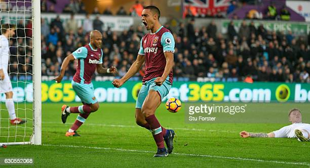 Winston Reid of West Ham United celebrates scoring his team's second goal with a header during the Premier League match between Swansea City and West...