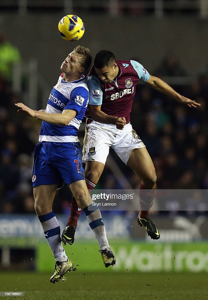 <a gi-track='captionPersonalityLinkClicked' href=/galleries/search?phrase=Winston+Reid&family=editorial&specificpeople=5491819 ng-click='$event.stopPropagation()'>Winston Reid</a> of West Ham United clashes off <a gi-track='captionPersonalityLinkClicked' href=/galleries/search?phrase=Pavel+Pogrebnyak&family=editorial&specificpeople=864025 ng-click='$event.stopPropagation()'>Pavel Pogrebnyak</a> of Reading during the Barclays Premier League match between Reading and West Ham United at the Madejski Stadium on December 29, 2012 in Reading, England.