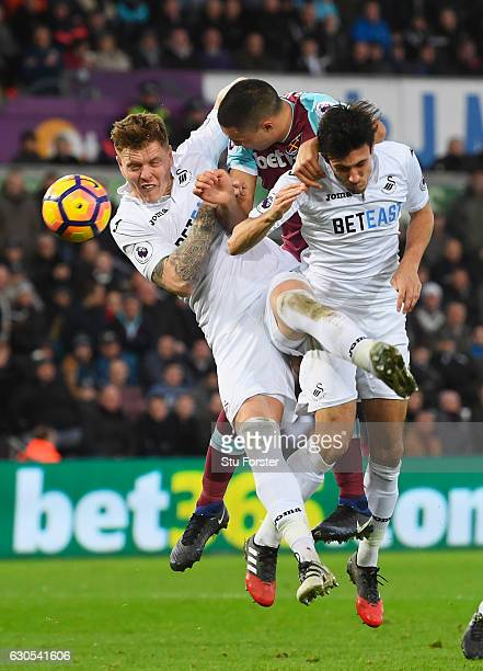 Winston Reid of West Ham United scores his team's second goal with a header during the Premier League match between Swansea City and West Ham United...