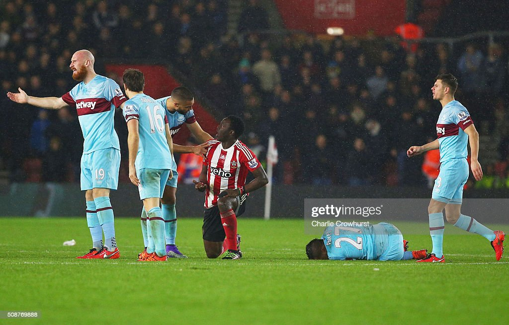 Winston Reid of West Ham United talks to Victor Wanyama of Southampton (3R) after his challenge on Dimitri Payet of West Ham United (2R) which sees him sent off during the Barclays Premier League match between Southampton and West Ham United at St Mary's Stadium on February 6, 2016 in Southampton, England.
