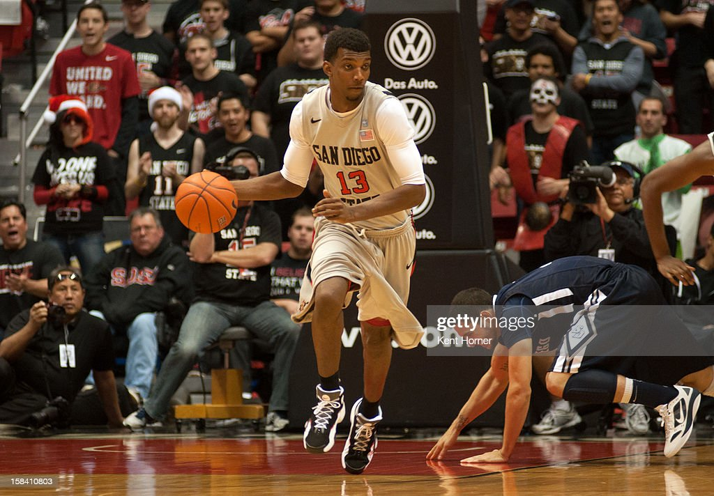 SAN DIEGO, CA - DECEMBER 15 - Winston Shepard #13 of the San Diego State Aztecs dribbles the ball in the second half of the game against the University of San Diego Tereros at Viejas Arena on December 15, 2012 in San Diego, California.