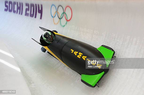 Winston Watts of Jamaica pilots a run during a Men's TwoMan Bobsleigh training session on day 7 of the Sochi 2014 Winter Olympics at the Sanki...