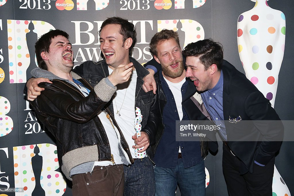 Winston-Marshall, Ben Lovett, Ted Dwane and Marcus Mumford of Mumford & Sons pose with their British Group award in the press room at the Brit Awards 2013 at the 02 Arena on February 20, 2013 in London, England.